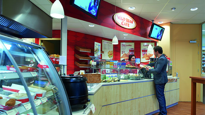 Shop in a petrol station lit with Philips shop lighting