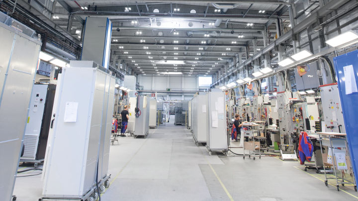 Staff working efficiently at ABB Drives lit by Philips Lighting