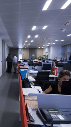 Employers working efficiently under energy-saving LED lights by Philips Lighting at E.ON, Spain