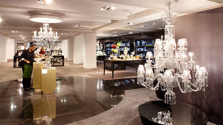 Illuminating sales floor at Harrods, UK with Philips lamps for chandeliers