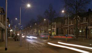 Busy street in a residential area lit by Philips