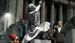 People admire a statue illuminated with Philips white light
