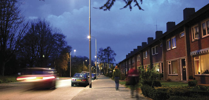 Cars in a street effectively illuminated with Philips white light